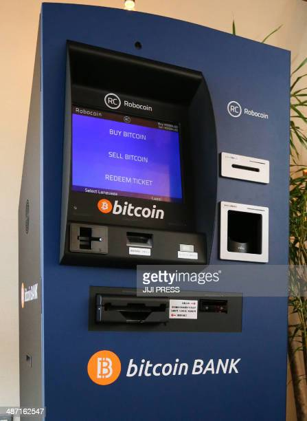 This picture taken on April 25 2014 shows Japan's first bitcoin auto teller machine produced by Robocoin and imported from the United States at...