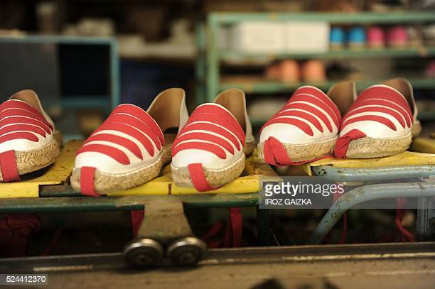 This picture taken on April 25 shows manufactured trout skin espadrilles in MauleonLicharre on April 25 2016 The 'Donquichosse' espadrilles factory...