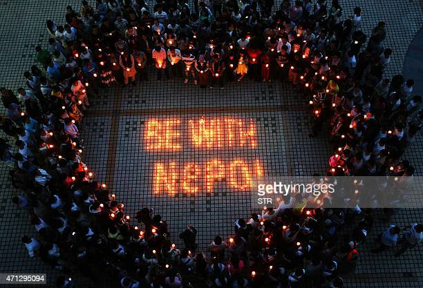 This picture taken on April 26 2015 shows Nepalese students and Chinese students gathering to pray for Nepal in Nanhua University in Hengyang central...