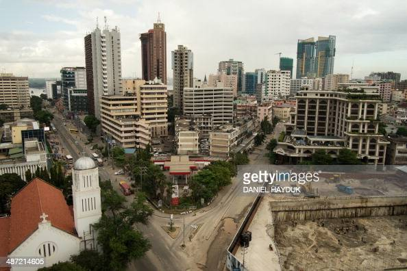 This picture taken on April 27 2014 shows building in central Dar es Salaam Many historic buildings some of which have been destroyed hold a largely...