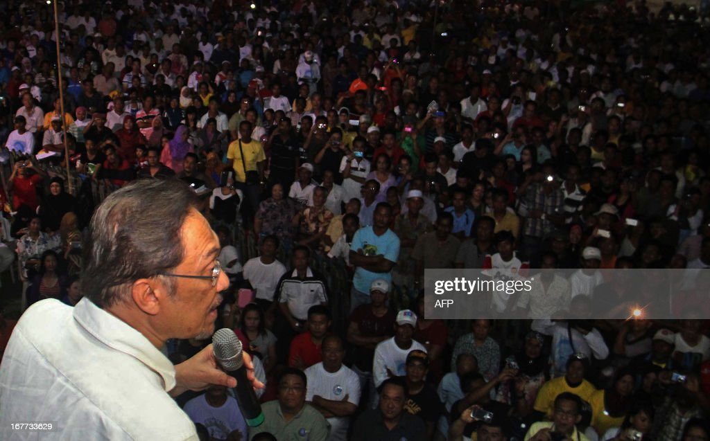 This picture taken on April 28, 2013 shows Malaysia's opposition leader Anwar Ibrahim addressing supporters during a campaign event ahead of the country's 13th general elections in Tawau, on the southeast coast of Sabah, on the island of Borneo. Opposition leader Anwar Ibrahim held a slight edge in support over Malaysian Premier Najib Razak, according to a survey released on April 26 ahead of a hotly anticipated election showdown on May 5. AFP PHOTO / YUISRI YUS