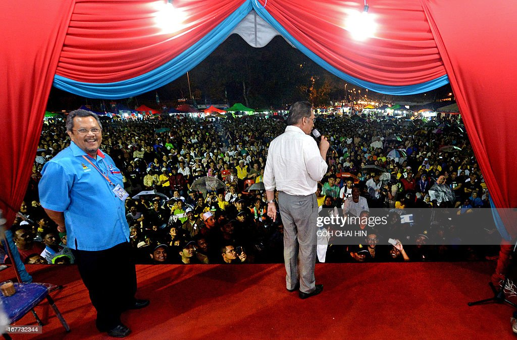 This picture taken on April 28, 2013 shows opposition leader Anwar Ibrahim (R) talking to the crowd during a rally in Sungai Buloh. Anwar Ibrahim holds a slight edge over Malaysian premier Najib Razak ahead of a hotly anticipated election showdown on May 5, according to the latest opinion poll on April 26.