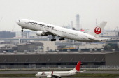 This picture taken on April 29 2014 shows a Japanese air carrier Japan Airlines plane taking off at Tokyo's Haneda airport Japan Airlines said on...