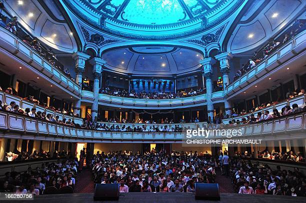 This picture taken on April 3 2013 shows a packed audience hall ahead of a performance by popular Vietnamese composer Phu Quang at Hanoi's Opera...