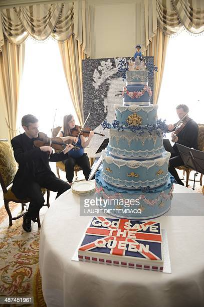 This picture taken on April 30 2014 shows the birthday cake with a statuette portraying Queen Elizabeth II on top at a birthday party in honor of the...