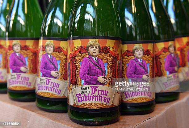 This picture taken on April 30 2015 shows bottles of beer from the Beer Theater restaurant and brewery named 'Frau Ribbentrop' featuring Chancellor...