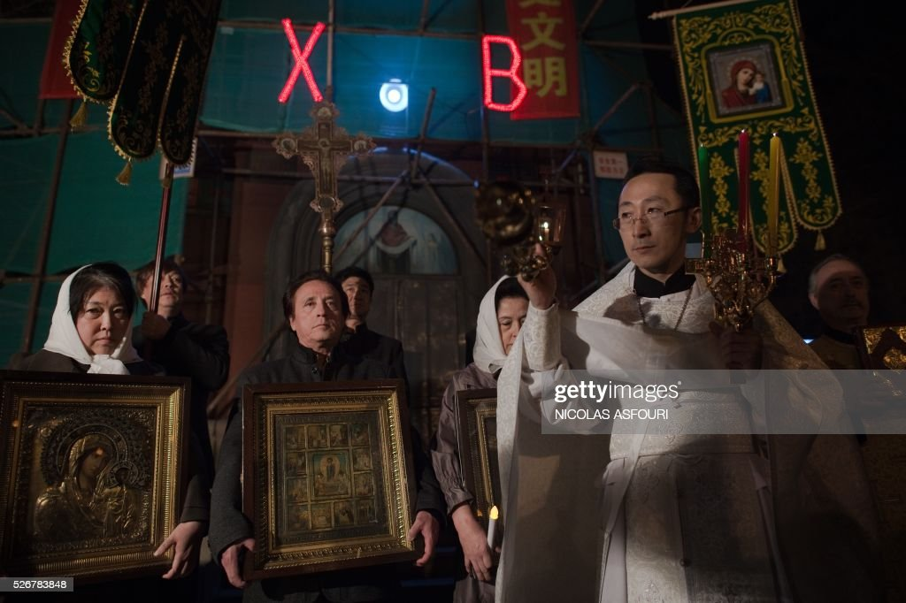 This picture taken on May 1, 2016 shows Chinese Priest Alexander Yu Shi during the Easter vigil service outside the Pokrov Orthodox church in Harbing. Shi is the first Chinese Priest ordained by Russian Orthodox Church for 60 years, and is also the first ever Orthodox Priest recognised by the Chinese Communist Party.