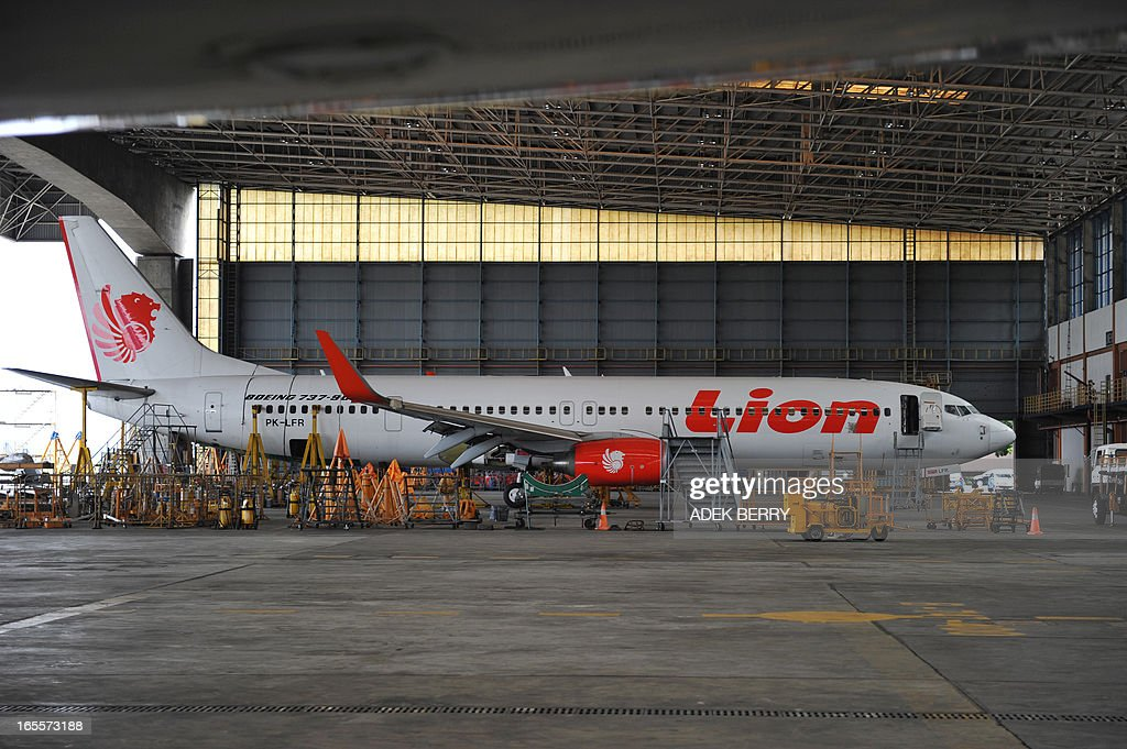 This picture taken on April 4, 2013 in Tangerang shows a Lion Air Boeing 737 plane parked at the hangar of the Sukarno-Hatta airport in Tangerang. A new rivalry between the world's biggest planemakers is heating up in Indonesia after a record deal for Airbus in a market with huge potential that until now has been a 'fortress' for Boeing. Indonesians are increasingly relying on air travel to link the archipelago of 17,000-odd islands, with up to 900 new planes set to be delivered to Indonesia in the next decade, according to the government. The potential is massive -- only six percent of Indonesians have travelled by air, according to officials, in a nation of 240 million people that has consistently clocked annual economic growth above six percent.