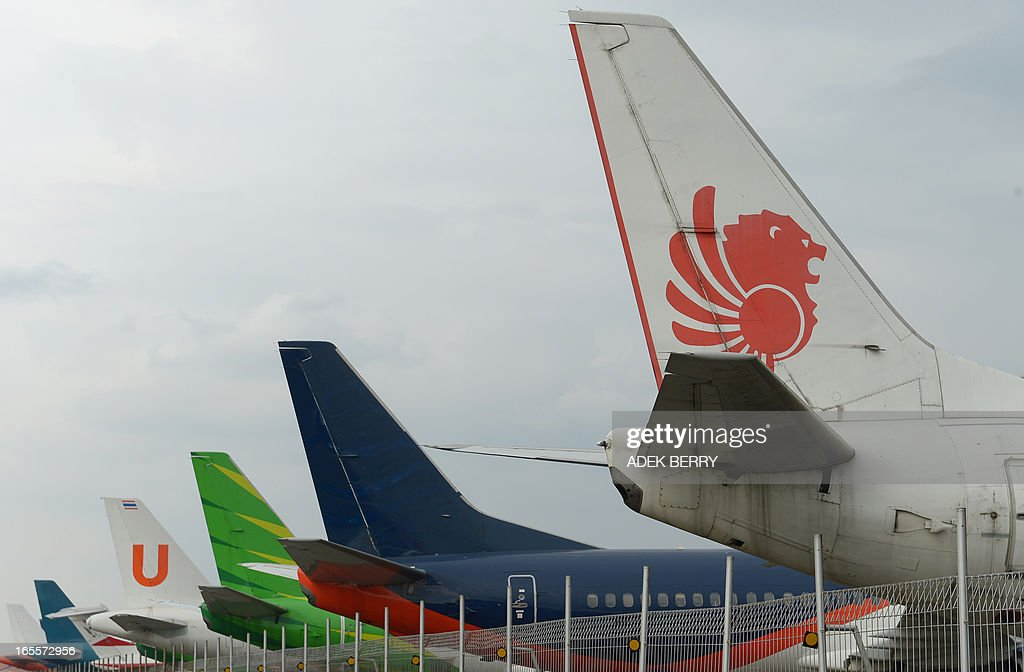 This picture taken on April 4, 2013 in Tangerang shows tails of Lion Air plane (1st R) with others planes parked at the hangar of the Sukarno-Hatta airport in Tangerang. A new rivalry between the worlds's biggest planemakers is heating up in Indonesia after a record deal for Airbus in a market with huge potential that until now has been a 'fortress' for Boeing. Indonesians are increasingly relying on air travel to link the archipelago of 17,000-odd islands, with up to 900 new planes set to be delivered to Indonesia in the next decade, according to the government. The potential is massive -- only six percent of Indonesians have travelled by air, according to officials, in a nation of 240 million people that has consistently clocked annual economic growth above six percent.