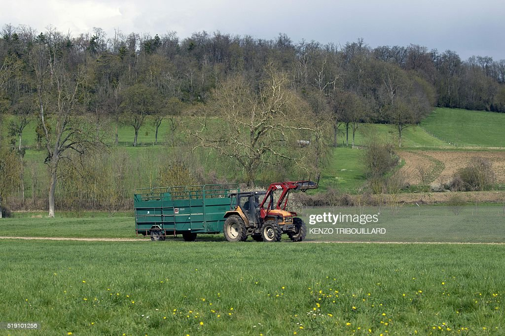This picture taken on April 4 shows a tractor in a park at ThivervalGrignon near Paris northern France ThivervalGrignon's castle and its 300 hectare...