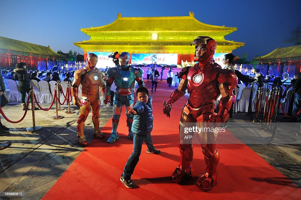 This picture taken on April 6, 2013 shows a boy posing during a promotional event for the Hollywood movie ''Iron Man 3'' at the Forbidden City in Beijing.