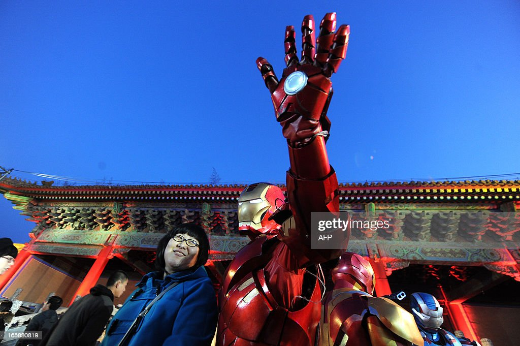 This picture taken on April 6, 2013 shows an attendee posing during a promotional event for the Hollywood movie ''Iron Man 3'' at the Forbidden City in Beijing.