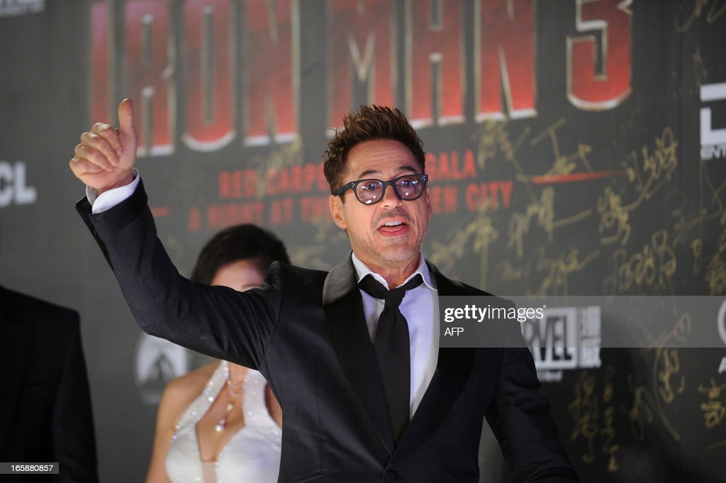 This picture taken on April 6, 2013 shows Hollywood actor Robert Downey Jr. giving a thumbs up during a promotional event for the Hollywood movie ''Iron Man 3'' at the Forbidden City in Beijing.