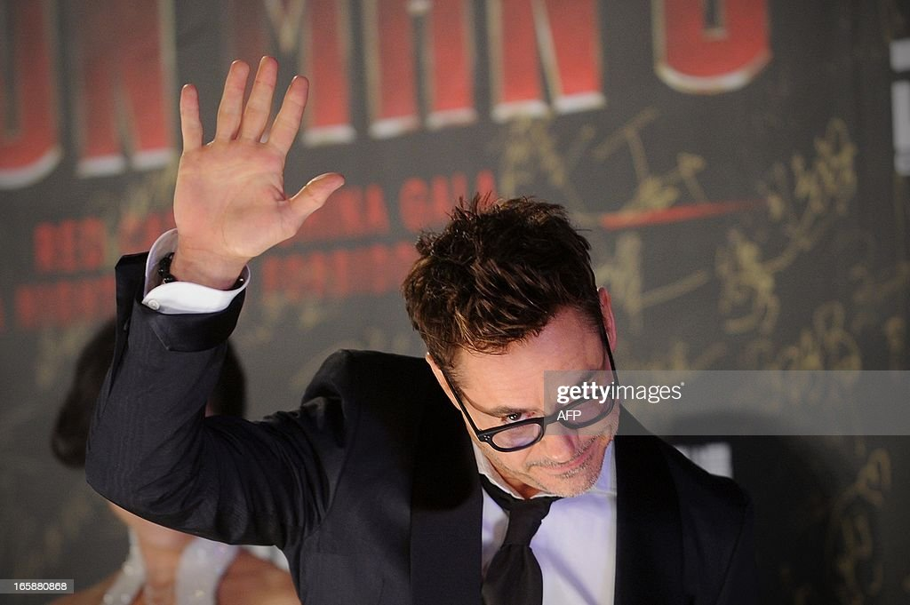 This picture taken on April 6, 2013 shows Hollywood actor Robert Downey Jr. waving to attendees during a promotional event for the Hollywood movie ''Iron Man 3'' at the Forbidden City in Beijing.