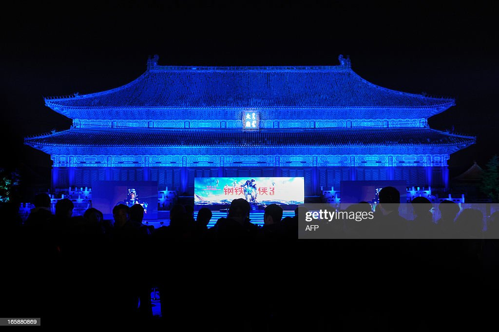 This picture taken on April 6, 2013 shows people attending apromotional event for the Hollywood movie ''Iron Man 3'' at the Forbidden City in Beijing.