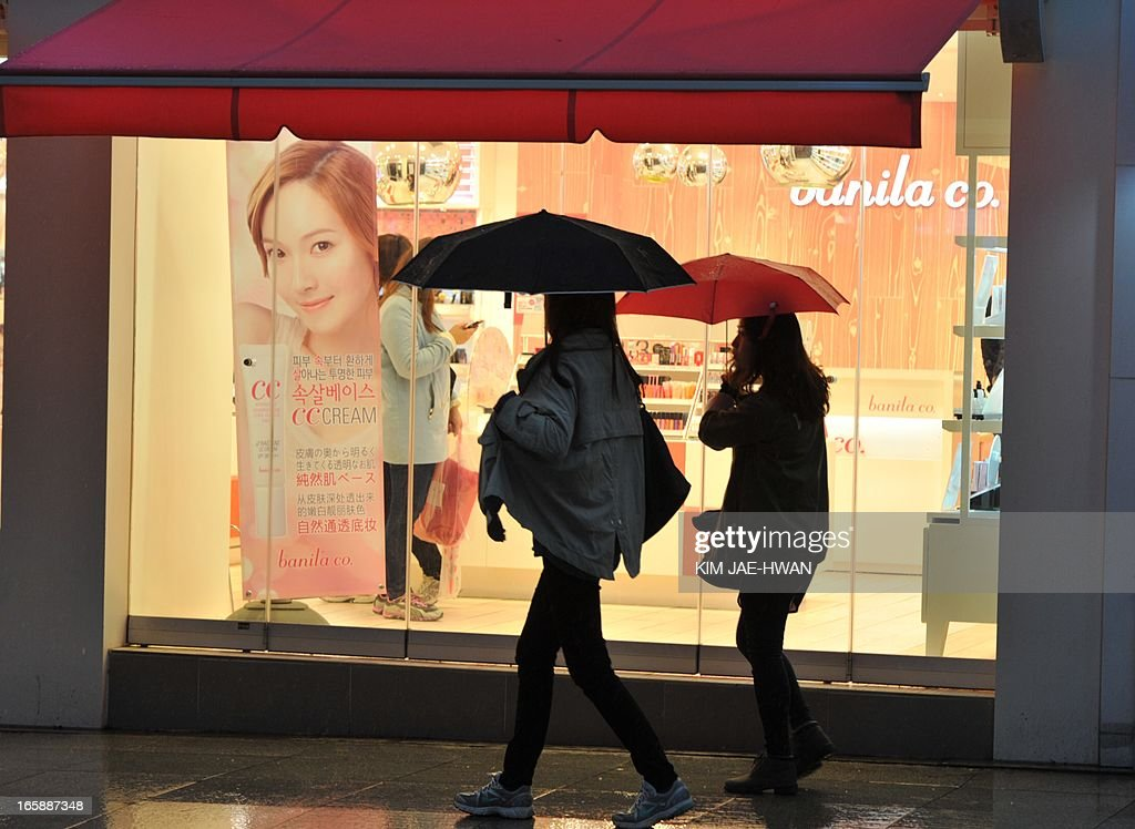 This picture taken on April 6, 2013, shows pedestrians in the shopping district of Gangnam in the South Korean capital Seoul, where businesses have remained as usual despite a recent series of apocalyptic military threats from North Korea. South Koreans are not immune to the anxiety generated by the North's toxic threats of nuclear war, but given that their country is the direct target of many of them, they seem remarkably unshaken.