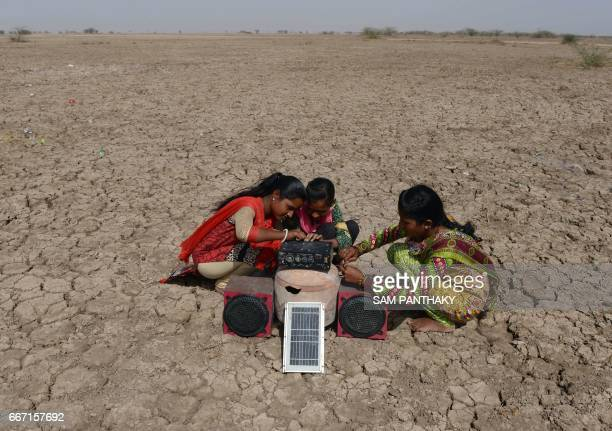 This picture taken on April 7 2017 shows Indian salt pan worker Puja Ganeshbhai Muladiya along with her sisters prepare for a traditional Garba as...