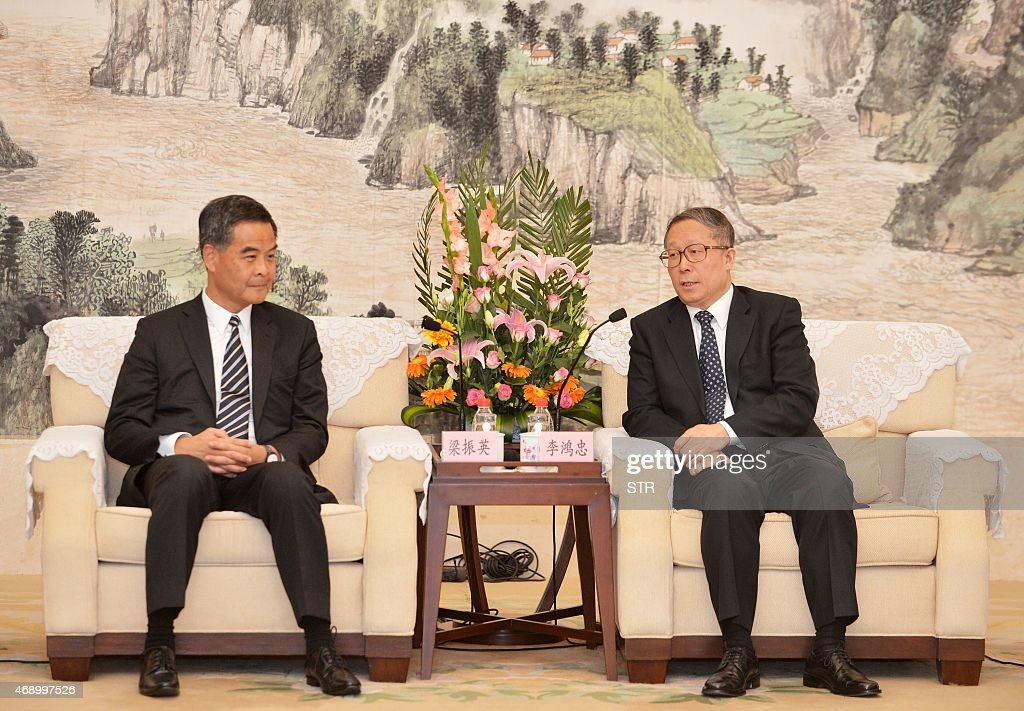 This picture taken on April 8 2015 shows Hong Kong's Chief Executive Leung Chunying meeting Hubei provincial Party chief Li Hongzhong during Leung's...