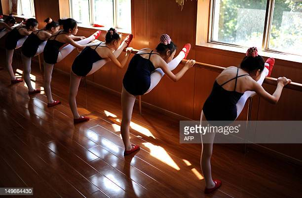 This picture taken on August 1 2012 shows a group of young Chinese girls taking part in a summer ballet class in Hefei east China's Anhui province...