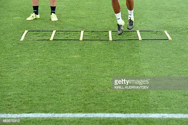 This picture taken on August 10 2015 at the Boris Paichadze Dinamo Arena in Tbilisi shows the feet of Sevilla FC players as they attend a training...