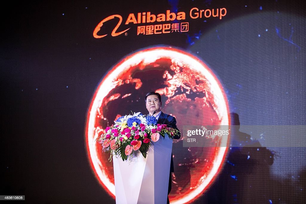 This picture taken on August 10 2015 shows Alibaba's founder and executive chairman Jack Ma delivering a speech at a conference announcing the...