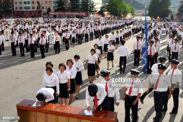This picture taken on August 10 2017 and released by North Korea's official Korean Central News Agency on August 13 2017 shows North Korean working...