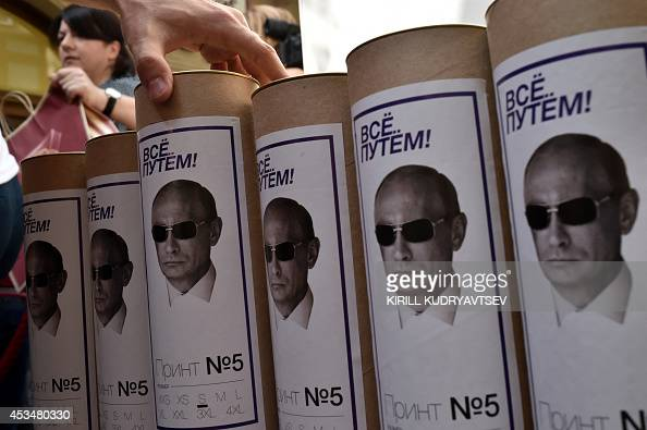 This picture taken on August 11 2014 shows boxes of Tshirts with portraits of Russia's President Vladimir Putin in a shop in central Moscow The sale...