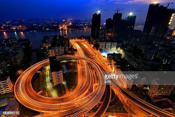 This picture taken on August 11 2015 shows a 'nail house' standing in the middle of a flyover in Guangzhou south China's Guangdong province Three key...