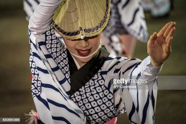 This picture taken on August 12 2017 shows a dancer of Ahouren performing during the Awa Odori festival in Tokushima The fourday dance festival...