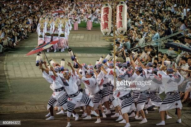This picture taken on August 12 2017 shows dancers of Ahouren performing during the Awa Odori festival in Tokushima The fourday dance festival...