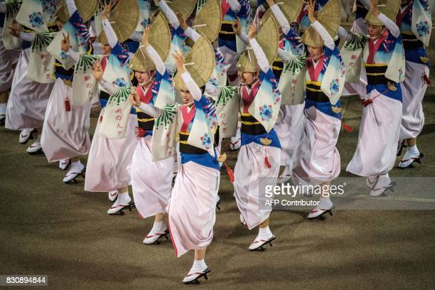 TOPSHOT This picture taken on August 12 2017 shows dancers of Shin Nonkiren performing during the Awa Odori festival in Tokushima The fourday dance...