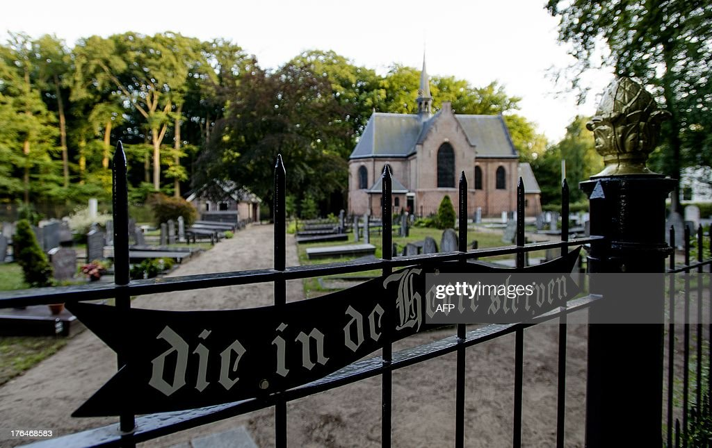 This picture taken on August 13, 2013 shows a general view of the cemetery and Stulp Church (background) in Lage Vuursche, about 30 kilometres (20 miles) southeast of Amsterdam. Dutch Prince Friso is to be buried near his mother's castle on August 16, 2013, days after he died from injuries sustained in a 2012 skiing accident, the palace said. King Willem-Alexander's brother Friso died on August 12, 2013, aged 44, around 18 months after after he was left brain-damaged and comatose by an avalanche while skiing in Austria.