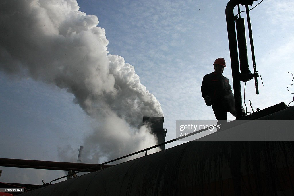 This picture taken on August 14, 2013 shows laborers working in a coal chemical factory in Huaibei, east China's Anhui province. China has soared almost to the top of the world's economic league tables, but whether the official data underpinning its status can be trusted is a constant headache, analysts say. CHINA