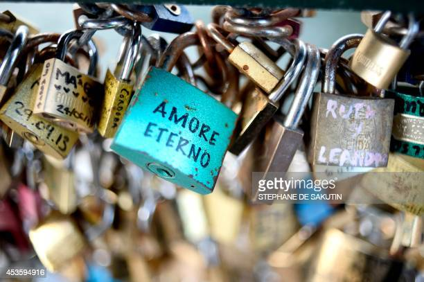 This picture taken on August 14 2014 shows love padlocks attached on the railings of the Pont des Arts in Paris Started by tourists in Paris in 2008...