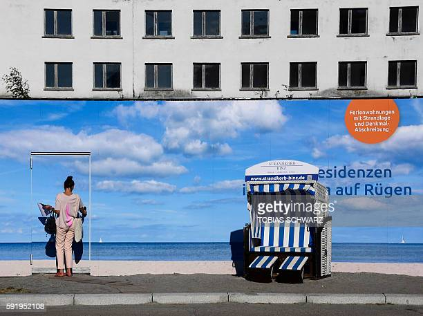 This picture taken on August 17 2016 shows an advertising banner in front of the heritageprotected Prora Complex that is being turned into luxury...