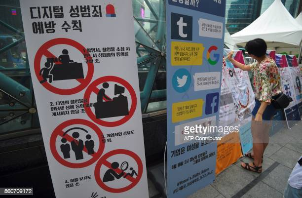 This picture taken on August 18 2017 shows signboards against digital sexcrimes during a protest to urge tech giants including Google Youtube...