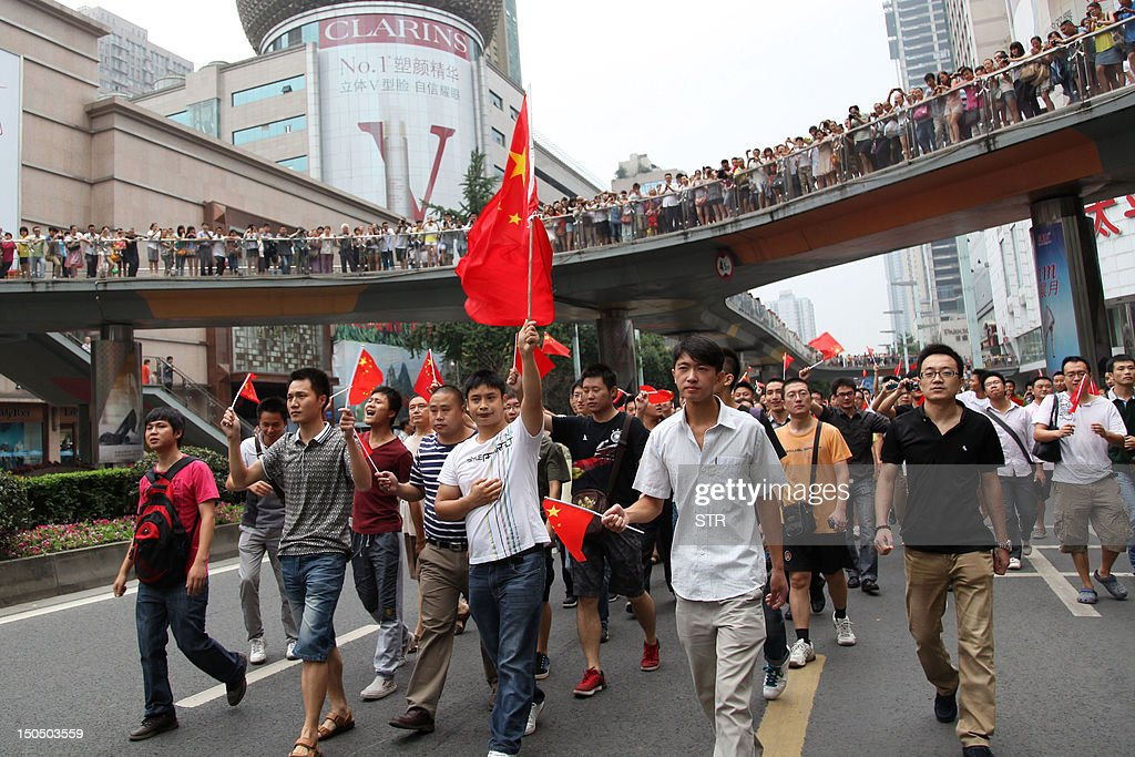 This picture taken on August 19, 2012 shows a group of Chinese protesters marching in a demonstration in Chengdu, southwest China's Sichuan province against Japan's claim of the Diaoyu islands, as they are known in Chinese, or Senkaku islands in Japanese. Anti-Japan protests broke out on August 19 in more than a dozen Chinese cities including Beijing and Hong Kong as authorities allowed thousands of people to vent anger over an escalating territorial row. CHINA