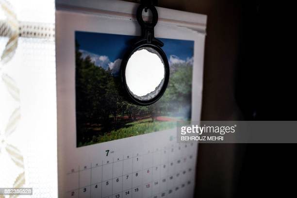 This picture taken on August 19 shows a mirror and a calendar in a small apartment of a man who died alone and left decomposing for three weeks in...
