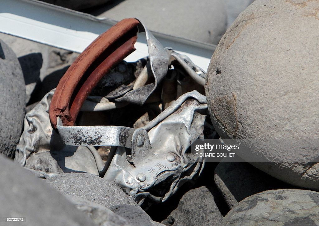 This picture taken on August 2 2015 shows metallic debris found on a beach in SaintDenis on the French Reunion Island in the Indian Ocean close to...