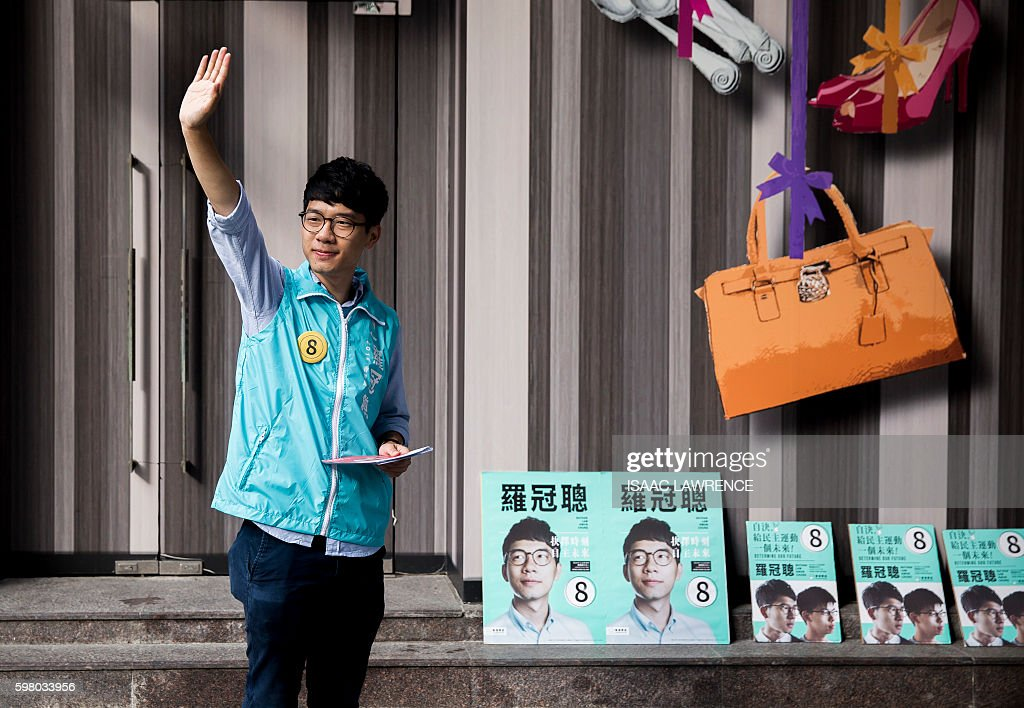This picture taken on August 22 2016 shows Nathan Law from the political party Demosisto campaigning in the Sai Wan Shan district of Hong Kong ahead...