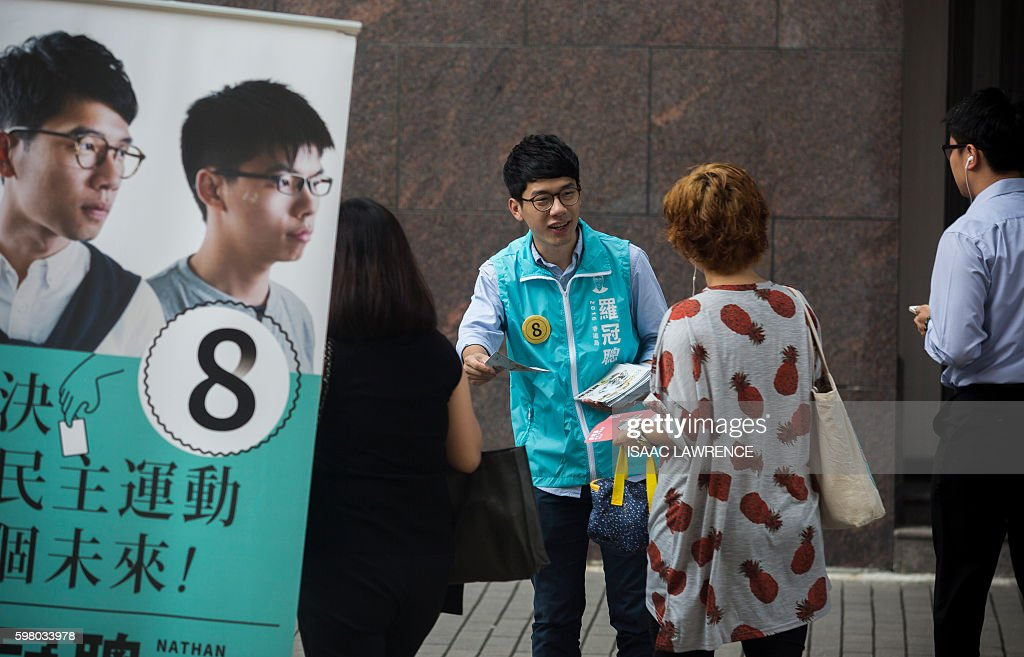 This picture taken on August 22 2016 shows Nathan Law from the political party Demosisto handing out election flyers in the Sai Wan Shan district of...