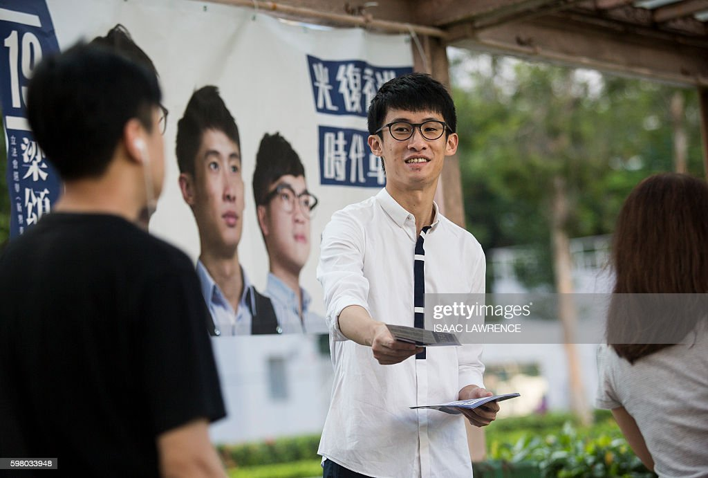 This picture taken on August 23 2016 shows Baggio Leung from the political party Youngspiration handing out election flyers in the Tseung Kwan O...