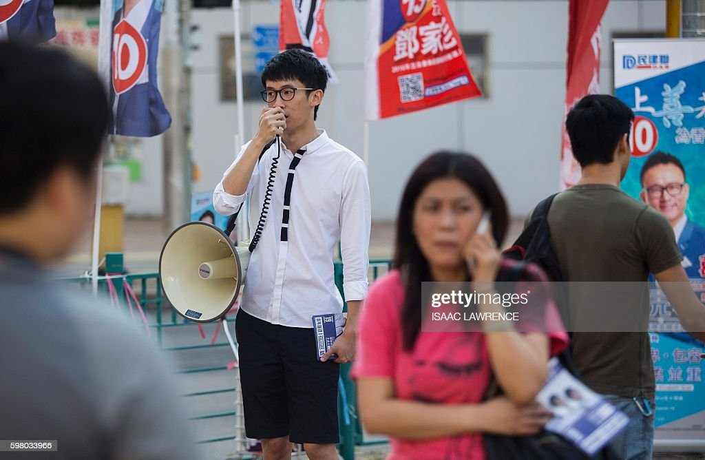 This picture taken on August 23 2016 shows Baggio Leung from the political party Youngspiration campaigning in the Tseung Kwan O district of Hong...