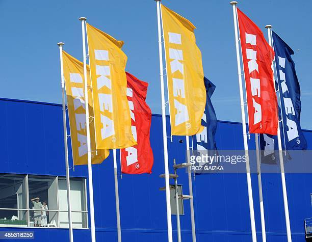 This picture taken on August 26 2015 shows Ikea flags in front of one of the facades of the new Ametzondo Bayonne Ikea store in SaintPierred'Irube...