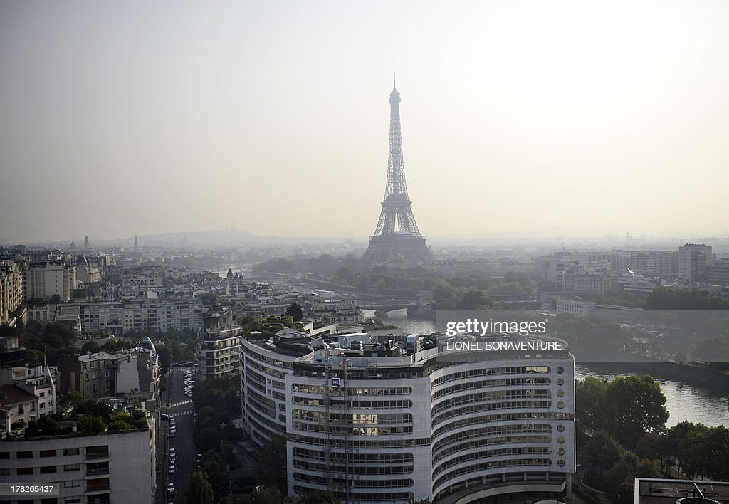 This picture taken on August 28, 2013 from the roof of the Maison de la Radio in Paris, shows the Seine river and the Eiffel tower.