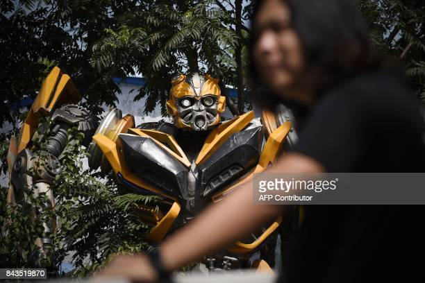This picture taken on August 29 2017 shows a transformerlike sculpture at Sun Shiqian's studio in Beijing Sun Shiqian's roomy warehouse on the...