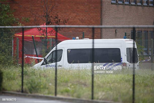 This picture taken on August 29 shows a police van parked outside the National Institute for Criminalistics and Criminology near the site of an...