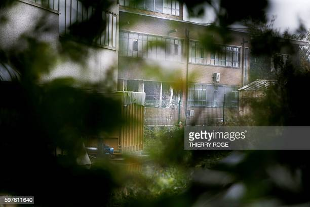 This picture taken on August 29 shows damaged windows of the National Institute for Criminalistics and Criminology after an explosion overnight in...