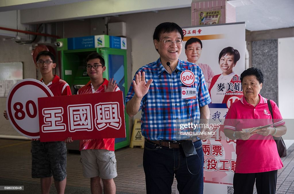 This picture taken on August 30 2016 shows proBeijing candidate Wong Kwokhing from the political party Hong Kong Federation of Trade Unions waving...