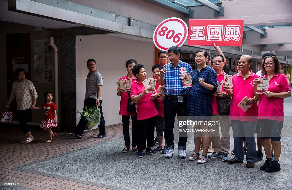 This picture taken on August 30 2016 shows proBeijing candidate Wong Kwokhing from the political party Hong Kong Federation of Trade Unions standing...